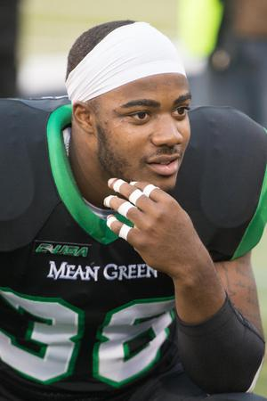 Primary view of object titled '[UNT Mean Green football player 4]'.