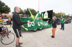 Primary view of object titled '[Jugglers in UNT Homecoming parade]'.