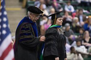 Primary view of object titled '[Graduate student at UNT Fall Commencement]'.