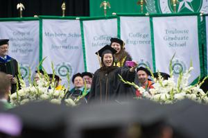 "Primary view of object titled '[Student takes ""selfie"" at UNT Commencement]'."