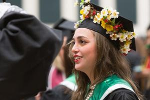 Primary view of object titled '[Student with decorated mortarboard at UNT Commencement]'.