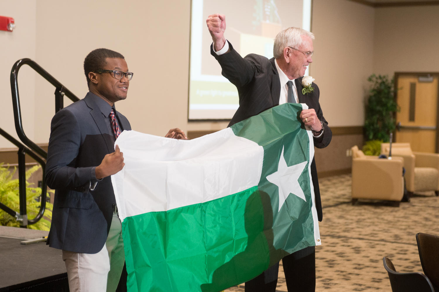 [V. Lane Rawlins with UNT flag]                                                                                                      [Sequence #]: 1 of 1