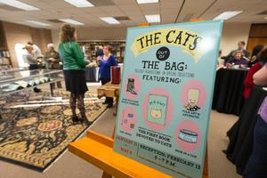 Primary view of object titled '[The Cat's Out of the Bag event sign]'.