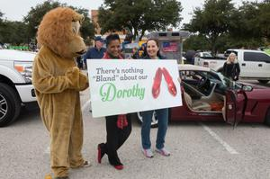 Primary view of object titled '[Dorothy Bland with sign at homecoming parade]'.