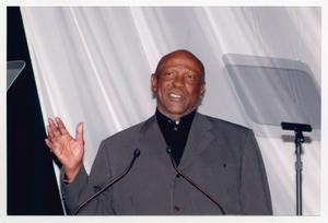 Primary view of object titled '[Louis Gossett Jr. Waving from Podium]'.