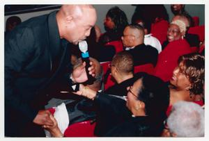 Primary view of object titled '[Peabo Bryson Singing to Audience Members]'.