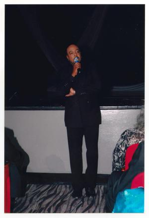 Primary view of object titled '[Peabo Bryson Speaking in Front of Stage]'.