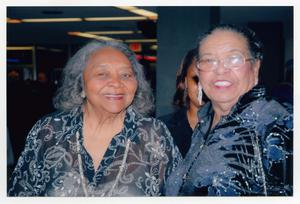 Primary view of object titled '[Juanita Moore Posing with Guest]'.