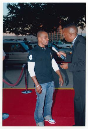 Primary view of object titled '[Kirk Franklin Speaking on the Red Carpet]'.