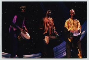 Primary view of object titled '[Three Drummers Dressed in Traditional African Costumes]'.