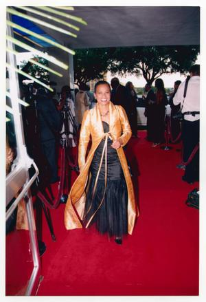 Primary view of object titled '[Harolyn Blackwell in Gold Coat Walking Down Red Carpet]'.