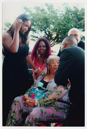 Primary view of object titled '[Della Reese on Red Carpet with Several Guests]'.