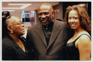 Primary view of object titled '[Louis Gossett Jr. with Two Guests]'.