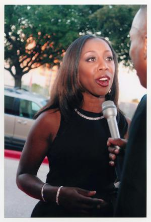 Primary view of object titled '[Oleta Adams Speaking to Interviewer on Red Carpet]'.