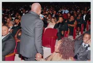 Primary view of object titled '[Peabo Bryson Holding Audience Member's Hand]'.