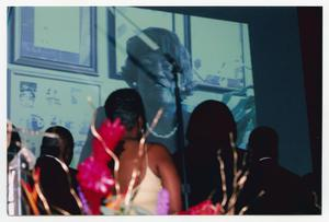 Primary view of object titled '[Several Guests Viewing Projection Screen]'.
