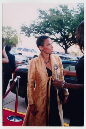 Primary view of object titled '[Harolyn Blackwell Speaking to Interviewer on Red Carpet]'.