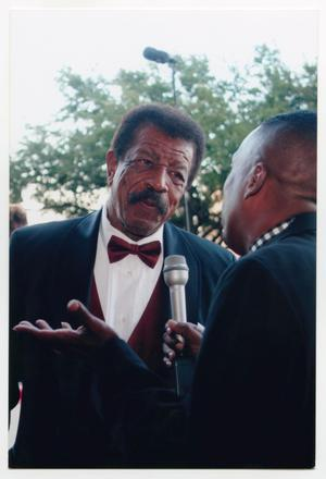 Primary view of object titled '[Hal Williams Speaking to Interviewer on Red Carpet]'.