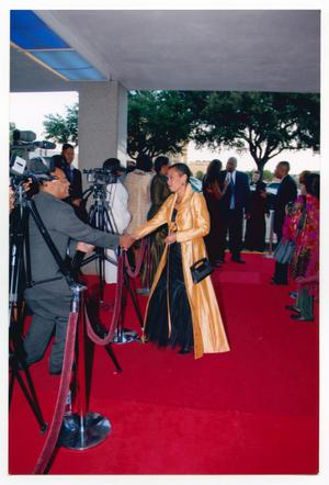 Primary view of object titled '[Harolyn Blackwell in Gold Coat on Red Carpet]'.