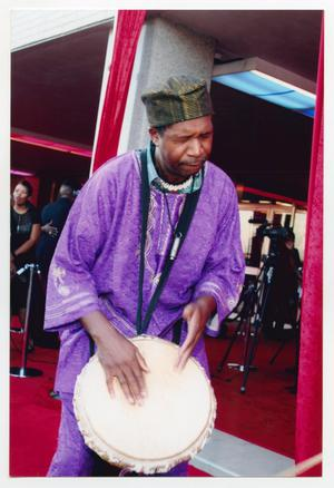 Primary view of object titled '[Drummer Performing on Red Carpet]'.