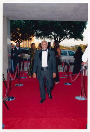 Primary view of object titled '[Man Walking Down Red Carpet]'.