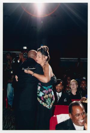 Primary view of object titled '[Peabo Bryson Hugging Audience Member]'.