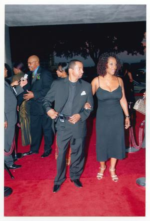 Primary view of object titled '[Man and Woman Arriving Together on Red Carpet]'.
