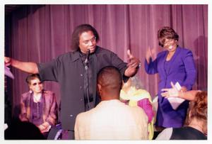 Primary view of object titled '[Curtis King on Stage with Guests]'.