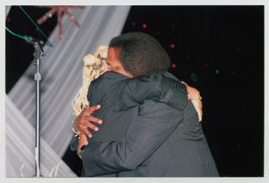 Primary view of object titled '[Curtis King Embracing Kim Fields]'.