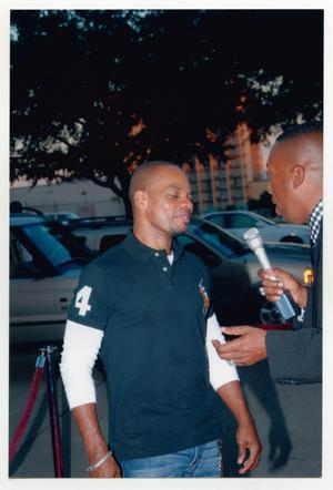 Primary view of object titled '[Kirk Franklin Being Interviewed on the Red Carpet]'.