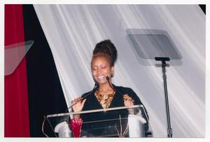 Primary view of object titled '[Erykah Badu Speaking on Stage]'.