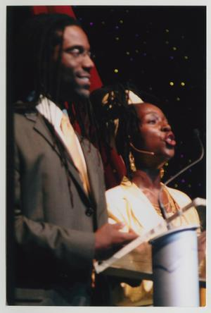 Primary view of object titled '[Timothy and Phyllis Yvonne Stickney Speaking on Stage]'.
