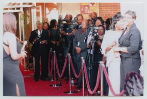 Primary view of object titled '[Several Cameramen and Interviewers on Red Carpet]'.