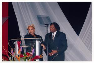 Primary view of object titled '[Curtis King with Kim Fields]'.
