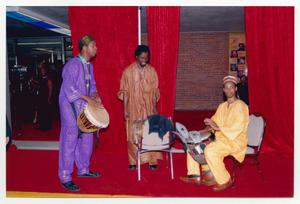 Primary view of object titled '[Three Drummers Performing on Red Carpet]'.