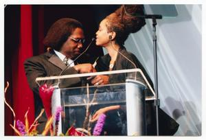 Primary view of object titled '[Curtis King with Erykah Badu at TBAAL Anniversary Gala]'.