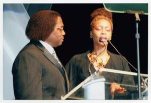 Primary view of object titled '[Curtis King and Eryka Badu at Podium]'.