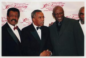 Primary view of object titled '[Louis Gossett Jr., Bill Cobbs, and Hal Williams with Guest]'.