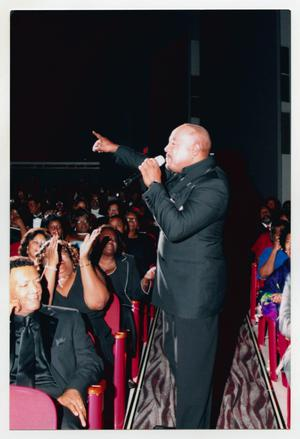 Primary view of object titled '[Peabo Bryson Singing in the Audience]'.