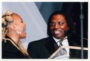 Primary view of object titled '[Curtis King on Stage with Kim Fields]'.