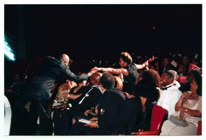 Primary view of object titled '[Peabo Bryson Performing and Reaching Into Audience]'.
