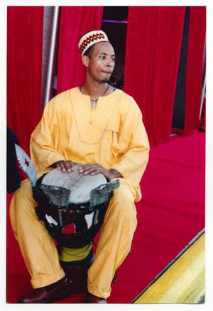 Primary view of object titled '[Traditionally Dressed Drummer on Red Carpet]'.