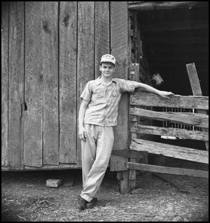 Primary view of object titled '[Raymond Clark at Grandpa's Barn]'.