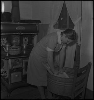 Primary view of object titled '[Virginia Clark washing clothes]'.