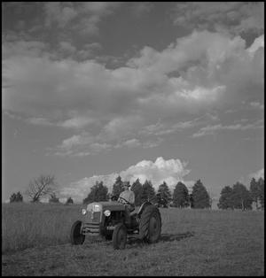 Primary view of object titled '[Wade Clark on tractor]'.