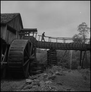 Primary view of object titled '[Crossing a water mill bridge]'.