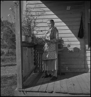 Primary view of object titled '[Woman on the porch]'.