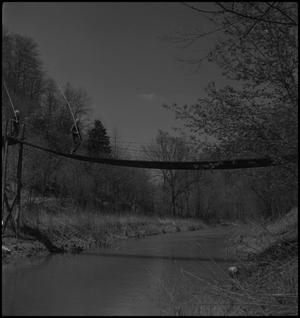 Primary view of object titled '[Walking on a swinging bridge]'.