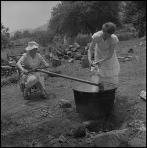 Primary view of object titled '[Making apple butter]'.