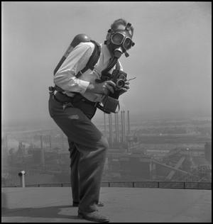 Primary view of object titled '[Joe Clark in a gas mask]'.